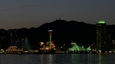 Port Of Kobe Lighting Up As The Sun Rises Behind The Mountains stock footage