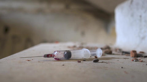 Used syringe is laying at the stairs Live Action