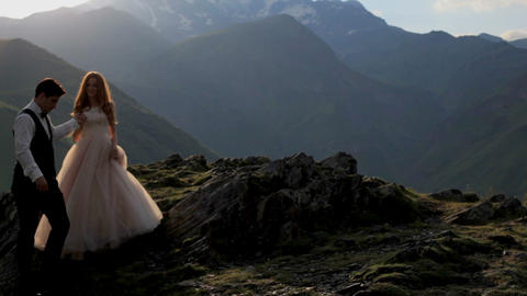 A magnificent bride and groom against the background of the majestic mountains Footage