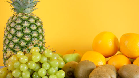 Healthy and organic exotic fruits on yellow background Footage