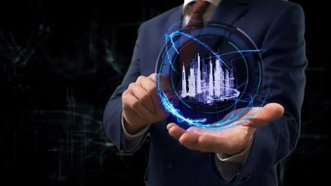 Businessman shows concept hologram 3d smart city on his hand Photo