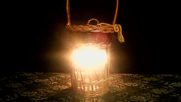 The candle burns near the basket Footage