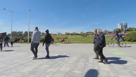 Timelapse of People Walking on Sunny Day Near Park GIF