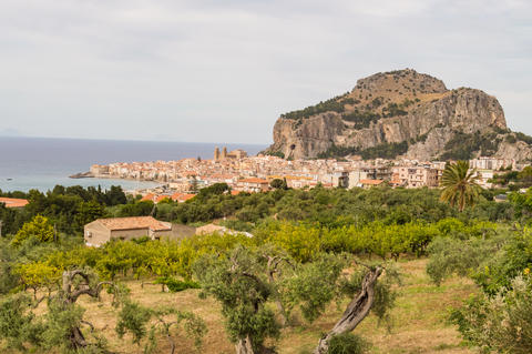 View of the city of Cefalu, its basilica and its rock Photo