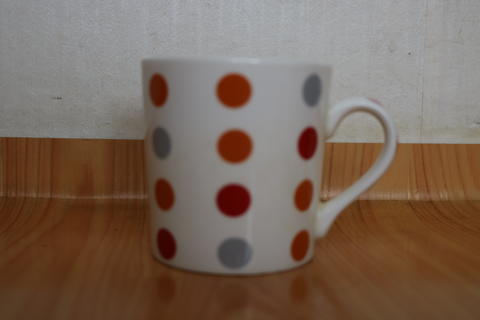 Colorful coffee white mug over wooden floor Fotografía