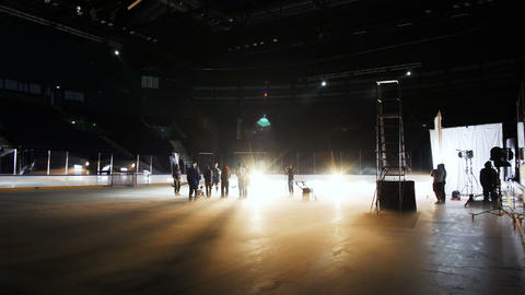 timelapse people prepare concert equipment among ice arena Archivo