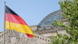 German Flag In Front of The Reichstag in Berlin, Germany Fluttering In The Wind 영상물