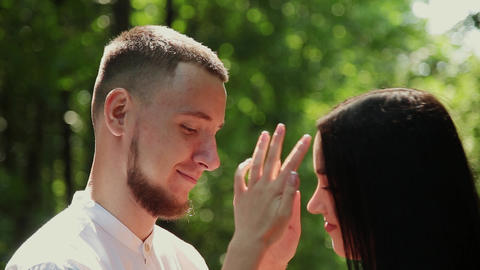 Lovers hugging in a green park on a sunny day Footage