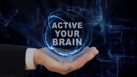 Painted hand shows concept hologram Active your brain on his hand フォト