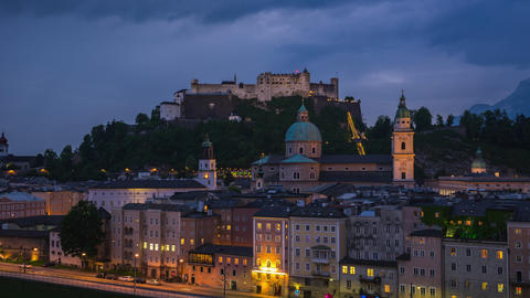 Day to Night time lapse video of Salzburg old town city skyline in Austria Footage