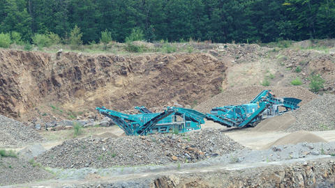Stone crusher in the quarry. Working mining machine - stone crusher. Quarrying Live Action