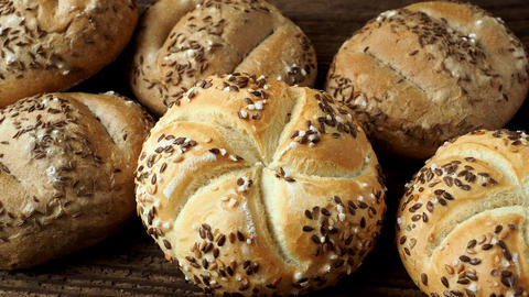 Different bread on a rustic wooden background. Bakery assortment of bread Footage