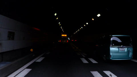 Highway Patrol escort exiting the tunnel on the Kyoto Highway Footage