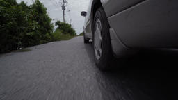 Driving a car on a country road. Wheels spinning POV. View from under the car 영상물