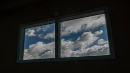 Time lapse shot of old windows with clouds moving in background 영상물