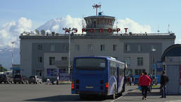 Passengers boarding an intercity bus driving from airport to city ビデオ