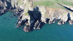 Aerial view of the beautiful cliffs close to the historic South Stack lighthouse Footage