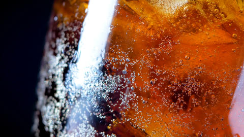 4K cola soda rootbeer mixed water in the glass with ice GIF