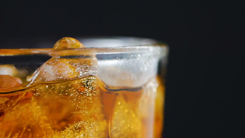 Air bubble and ice and liqueur brandy in the glass ライブ動画