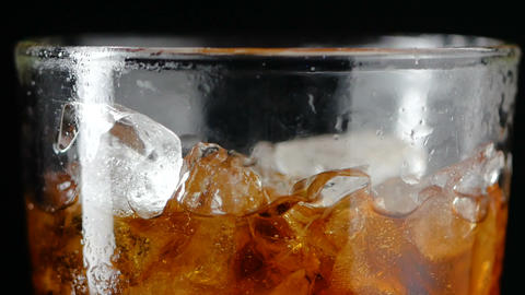 4K Slow motion pouring cola soda rootbeer mixed water in to the glass with ice GIF