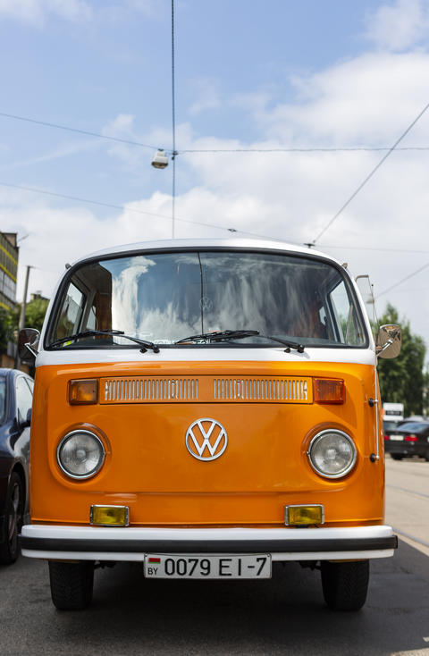 Minsk, Belarus, August 14 2018 - Orange and white Volkswagen Type 2 VW T2 parked Fotografía