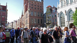 Gdansk, Poland. The old town, strolling tourists and Neptune fountain Live Action