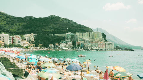 BUDVA, MONTENEGRO - AUGUST 1, 2018. Time lapse of crowded Becici beach on a GIF