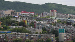 Old Soviet urban housing development on background of mountains and green forest Footage