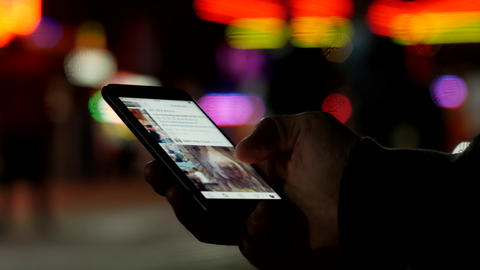 Instagram addiction - endless browsing of social media on a smartphone device Live Action