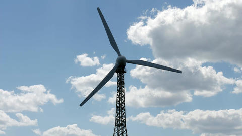 Windmill - source of eco renewable energy - close-up with cloudscape in Live Action
