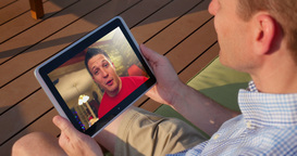 Man Videochats Outside with Tablet PC Footage
