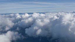 Aerial View Above Puffy Clouds Footage