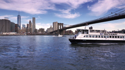 East River Ferry Passes Under Brooklyn Bridge Footage