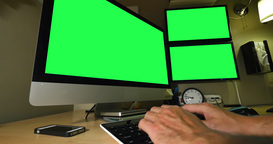 Working on PC with Green Screen Multiple Monitors Footage