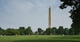 People Play Soccer near Washington Monument Footage