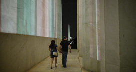 Couple Walks Outside Lincoln Memorial at Night Footage