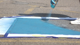 Painting Blue Square in Parking Lot for Handicap Space Footage
