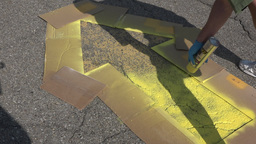 Painting Yellow Directional Arrow in Parking Lot Footage