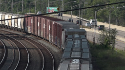 Freight Train Turns Bend in the Distance Footage