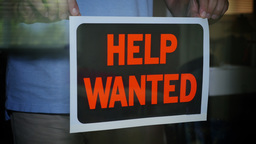 Help Wanted Sign is Placed in Store Window Footage