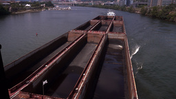 Coal Barge Travels on River Near Pittsburgh Footage