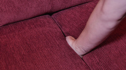 Finding Watch in Sofa Cushions Footage