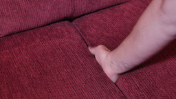 Finding Pearl Necklace in Sofa Cushions Footage