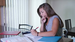 Teenaged Girl Does Homework In Kitchen stock footage