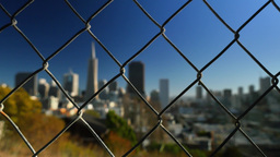 San Francisco Skyline Establishing Shot Through Chain Link Fence Footage
