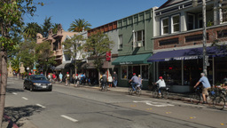 Bicyclists Ride in Downtown Sausalito California Footage