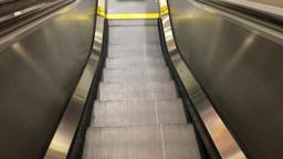 POV Riding Escalator Down Footage