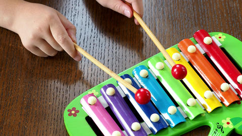 Musical instrument xylophone. Child playing on xylophone, musical instrument Live Action