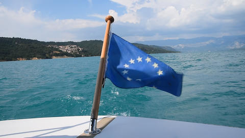 Close up flag of EU waving in wind on boat stern GIF