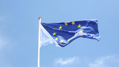 Close up flag of EU waving in wind over blue sky Footage